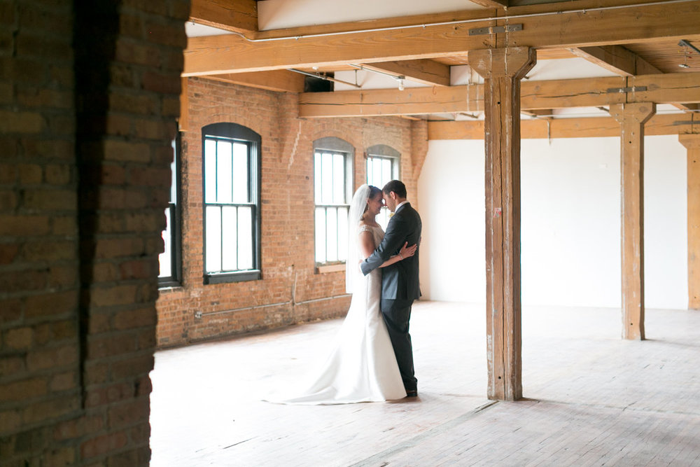 Vendors: Planner:  Ashley C. – Simply Elegant Group  | Photography: Wakefield Photo | Hair/Makeup:  Bev Esquivel – with Kate Johnson Artistry  | Venue:  Lacuna Artist Lofts   | Florist:  Victoria Claus – AEG Productions  | Caterer:  LM Catering   | Cake:  Sweet Mandy B's   | Ceremony Music:  Alex Sokol /  Common Knowledge | DJ:  Style Matters   | Lighting:  SC Lighting Design  | Photobooth:  Traveling Photo Booth  | Transportation:  Second City Trolley