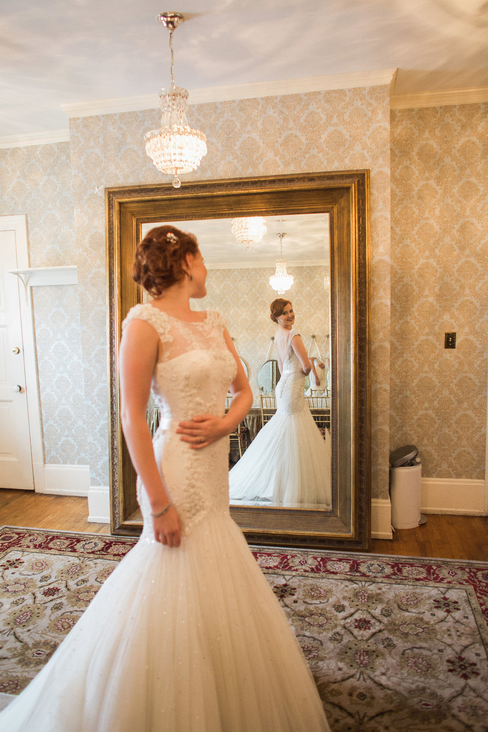 Bridal portrait. Bride in low back, fit and flare style beaded, tulle wedding dress from Kleinfeld.