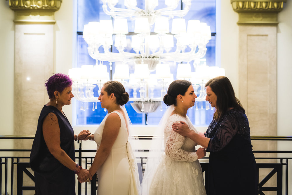 Same sex wedding first look for brides with their mothers