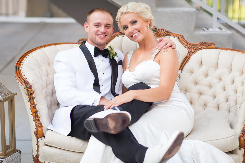 Bride and groom on vintage couch