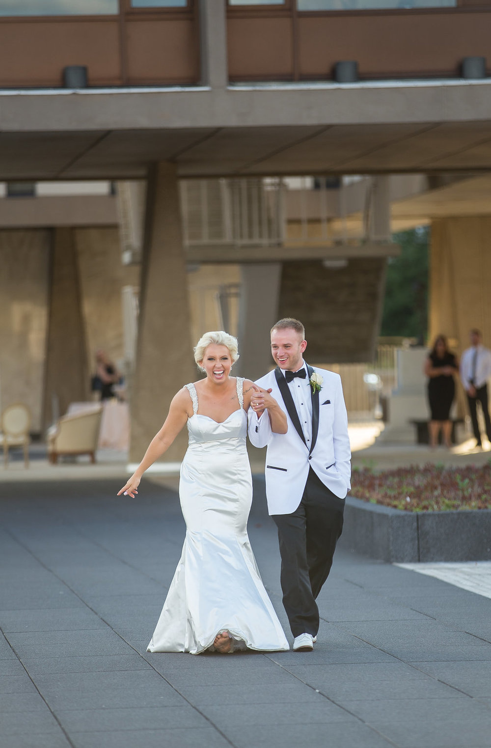 Bride and Groom's grand entrance to reception at The War Memorial Center, Fitch Plaza wedding
