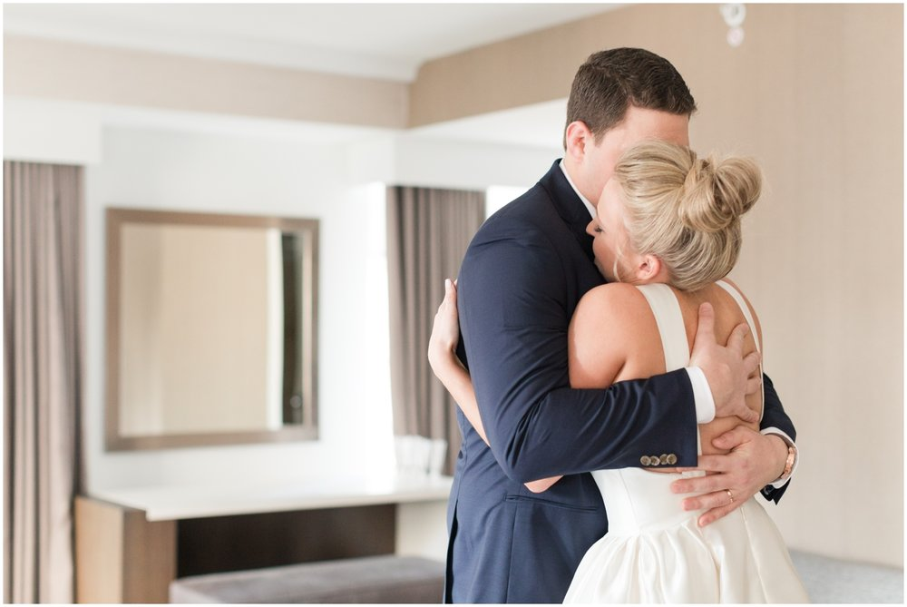 bride and groom hug before their wedding