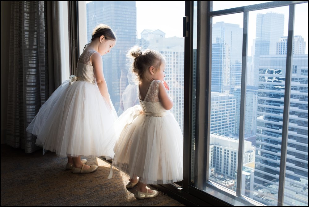 little girls looking at the window before a wedding