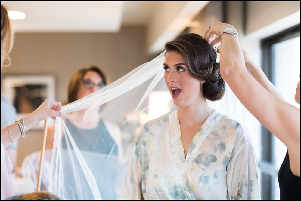 bride putting on her veil