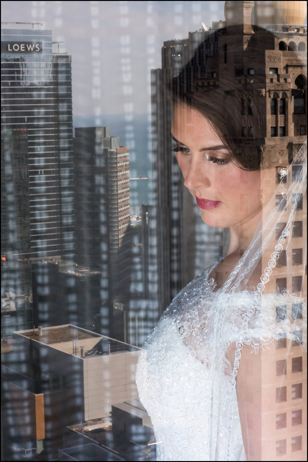 bride looking out at the city view of Chicago