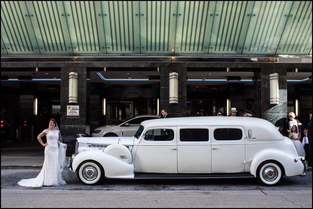 bride by the vintage car