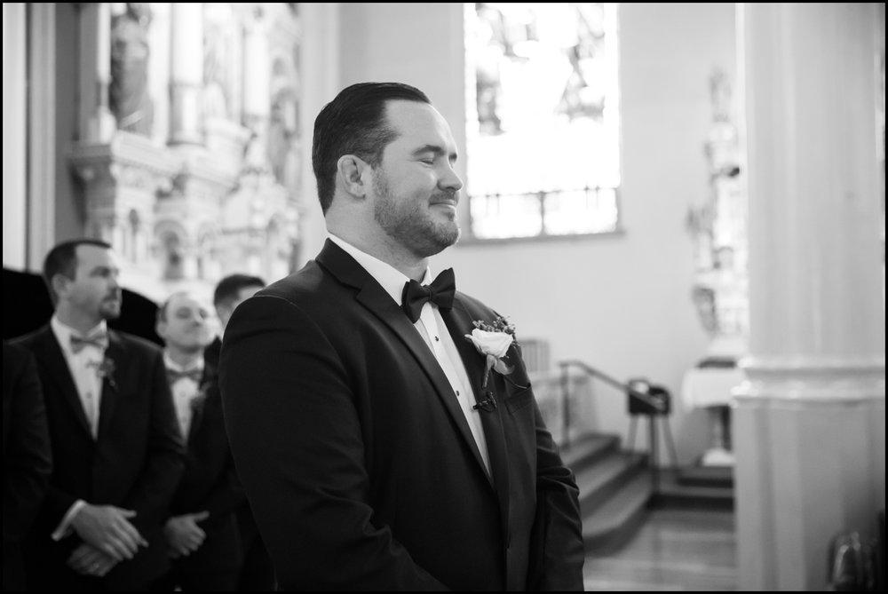groom gazing at his bride walking towards him