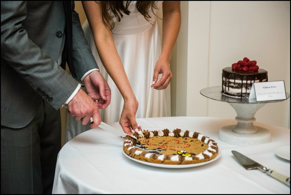 bride and groom cutting their cookie wedding cake