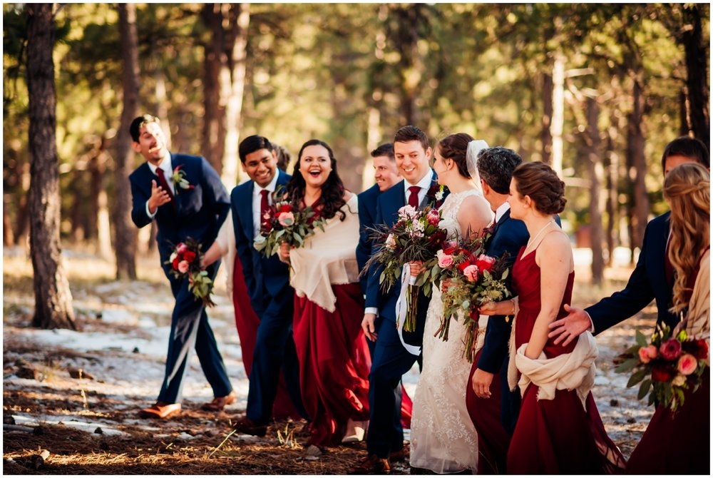 bridal party walking in the woods together