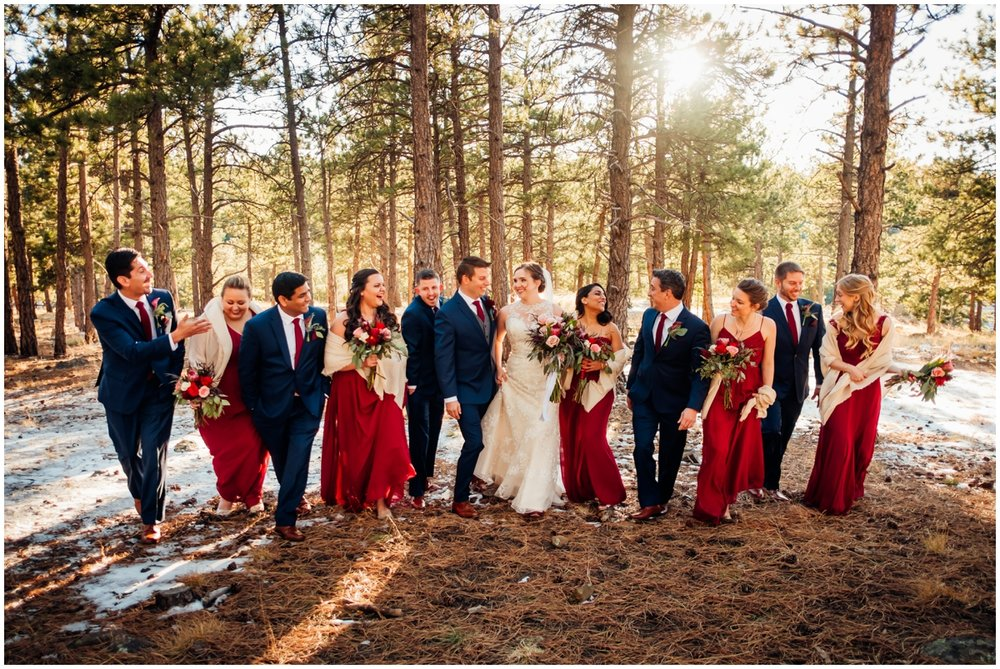 bridal party smiling with the bride and groom