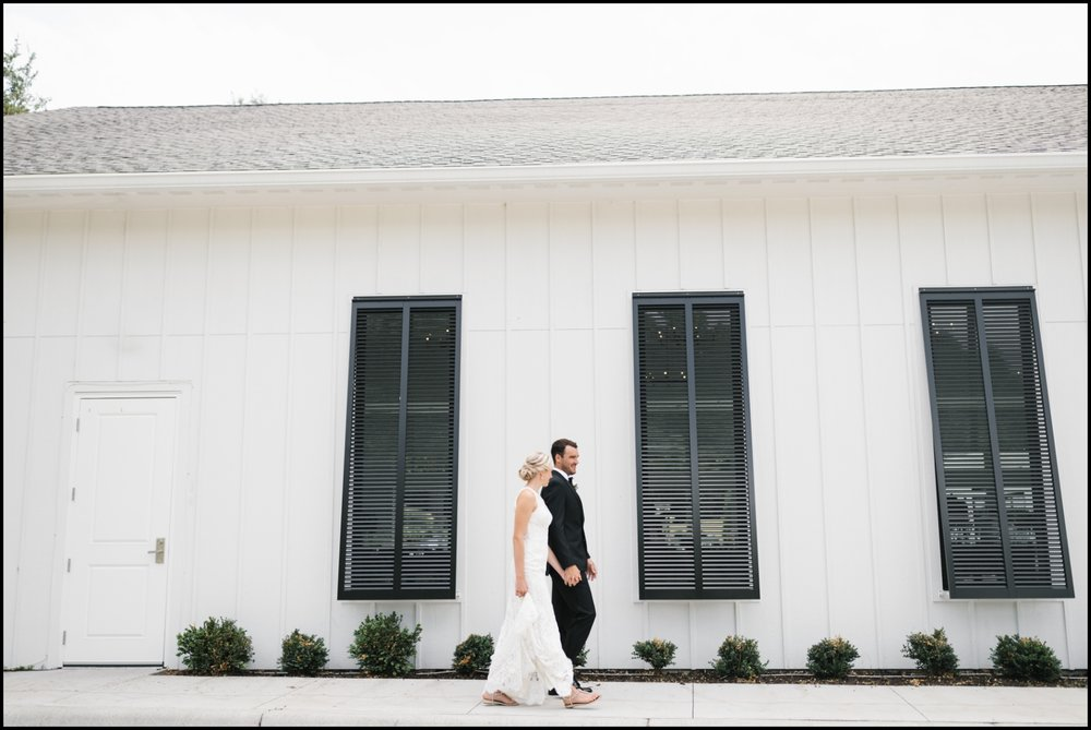 bride and groom walking in Hutton House