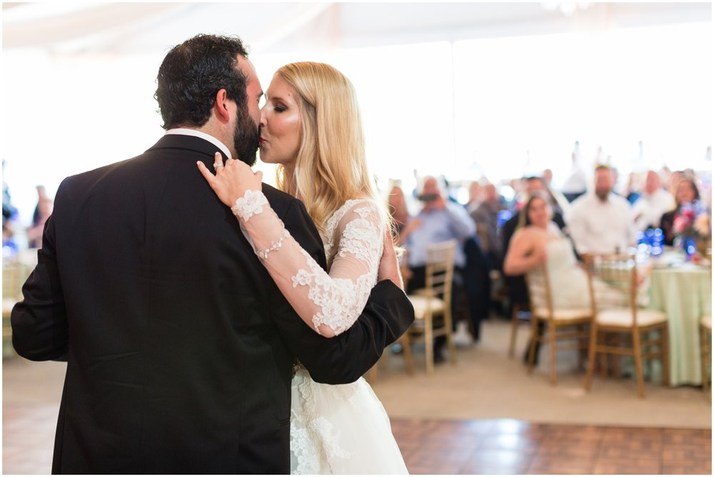 bride and groom kiss at the wedding
