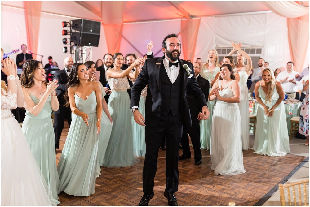 groom and the bridesmaids dancing