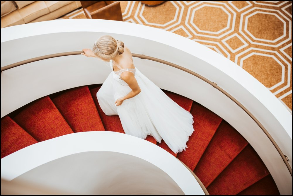 Bride walking up some red stairwell