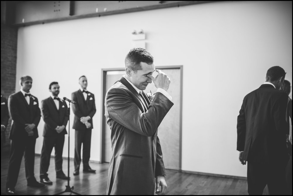 Groom tearing up as the bride walks down the aisle