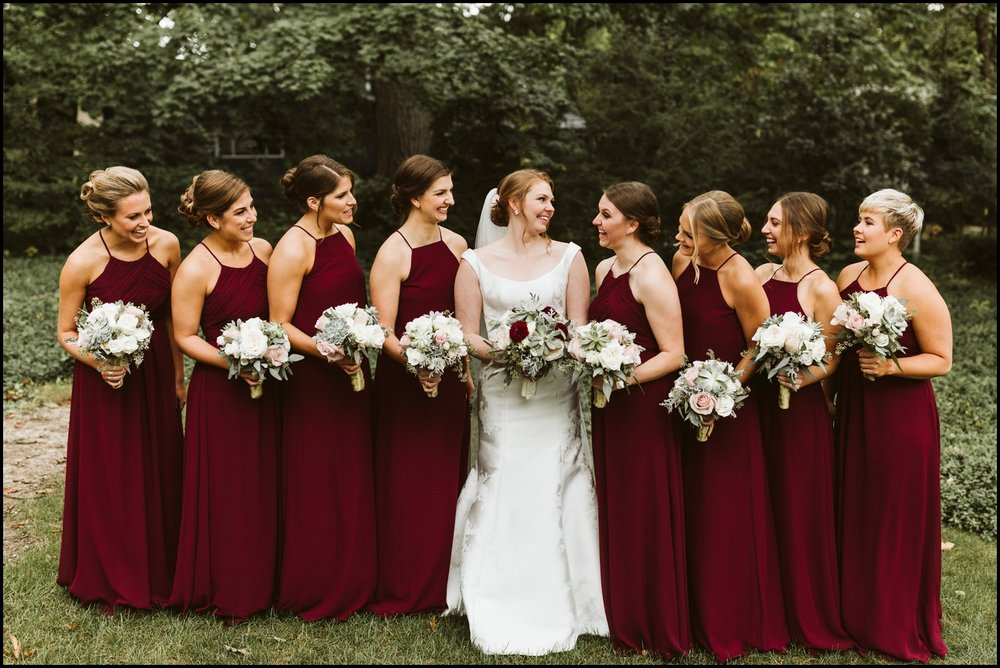 Bridesmaids and the bride with their wedding bouquets