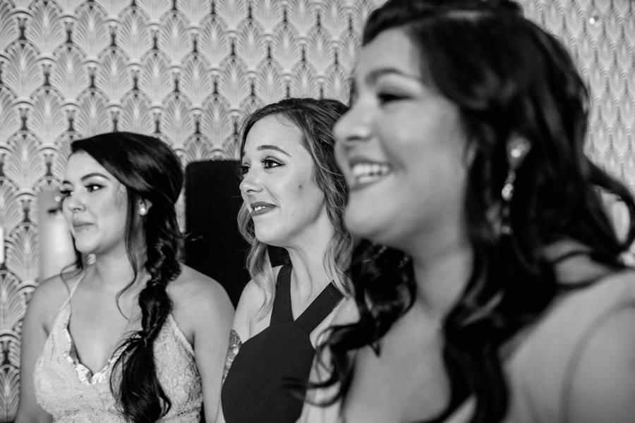 bridesmaids smiling at the bride