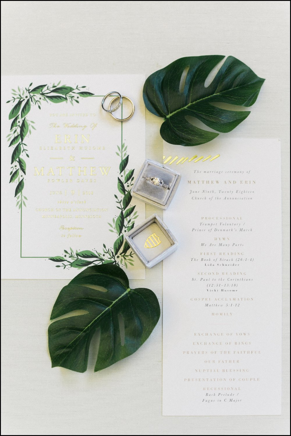 wedding invitation and wedding ring
