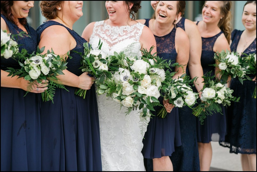 Bridesmaids holding their wedding bouquets