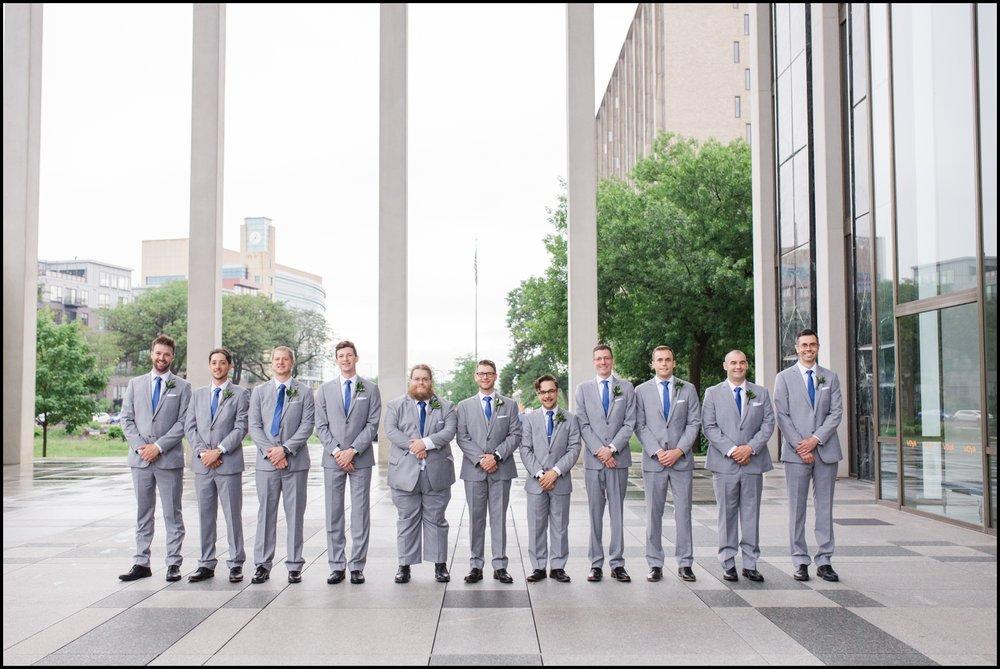 Groom and groomsmen pose