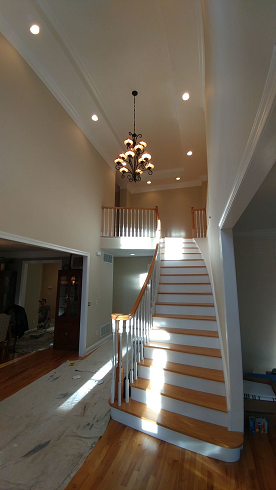 foyer ceiling, crown molding, stair, and wall painting