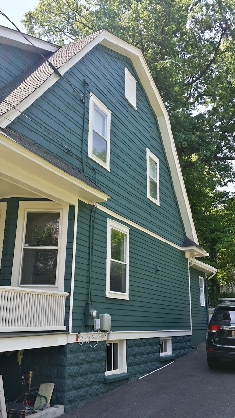 exterior wood home painted with benjamin moore tarrytown green by painting contractor