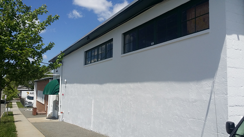 commercial exterior building painting by industrial painting company