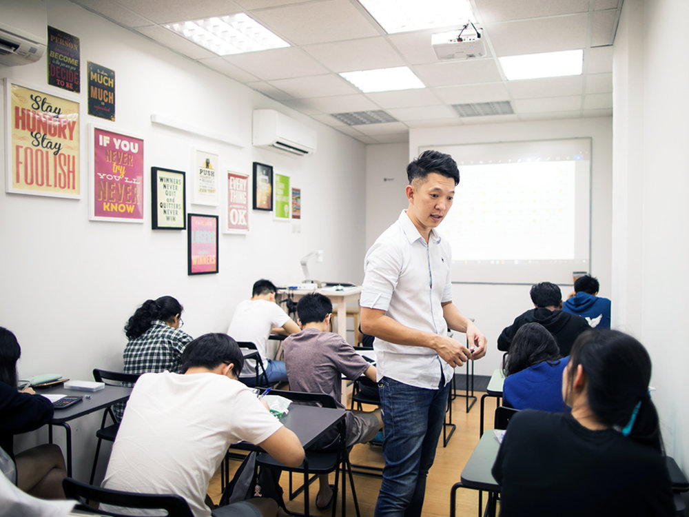With more than a decade of teaching experience in MOE schools, Calvin Kong had worked with a wide spectrum of students, ranging from those gifted in Physics to the ones who find the subject very challenging. These very important experiences had helped him develop an acute sense in picking the right words to explain concepts to the right students. In class, he memorises all the questions and answers that he provides his students for practice. Together with his years of experiences and familiarity with common difficulties faced by students, he is able to spot on students' difficulties and give quick and succinct feedback to help them move on. Every class is highly efficient.