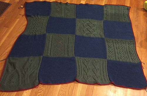 The afghan as of September 21, 2015. All of the pieces are knit, seamed together and edged in crochet.
