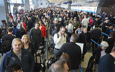 This image of dense crowds at an airport is from TravelAndLeisure.com. Sure looks leisurely to us. Oh wait, no it doesn't.