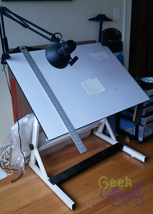 Ariela's drafting table with t-square hanging off it.