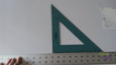 Ariela rests a triangle on her t-square.