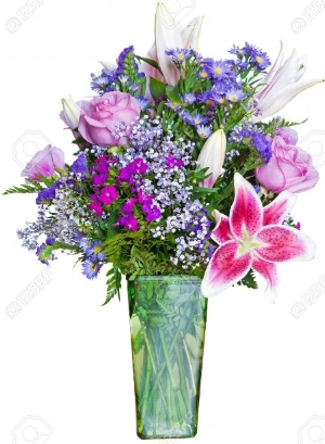 Stock photo of a bouquet of flowers in a green glass vase. It has pink roses, baby's breath, ferns, pink & white lilies, purple statice flowers, forget me nots, blue daisies and a purple flower not tagged. Photo via 123rf