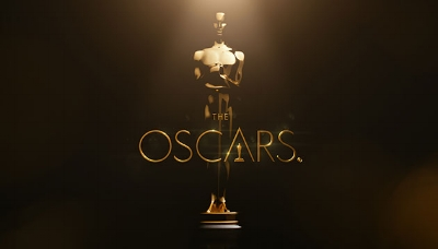 Image shows the Oscar statuette with the Oscars logo superimposed over it on a brown background. I remain amused that everyone has given up trying to call this The Academy Awards.