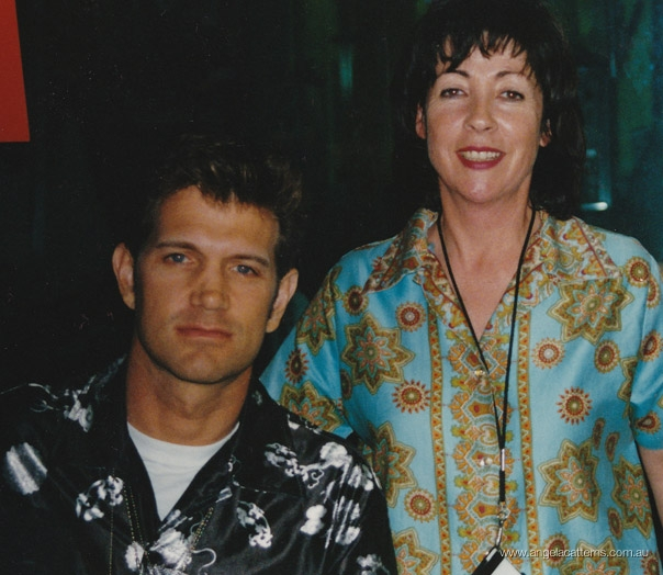 Angela Catterns with Chris Isaac   -   Triple J studio, 1990      Following a live performance on the Morning Show.