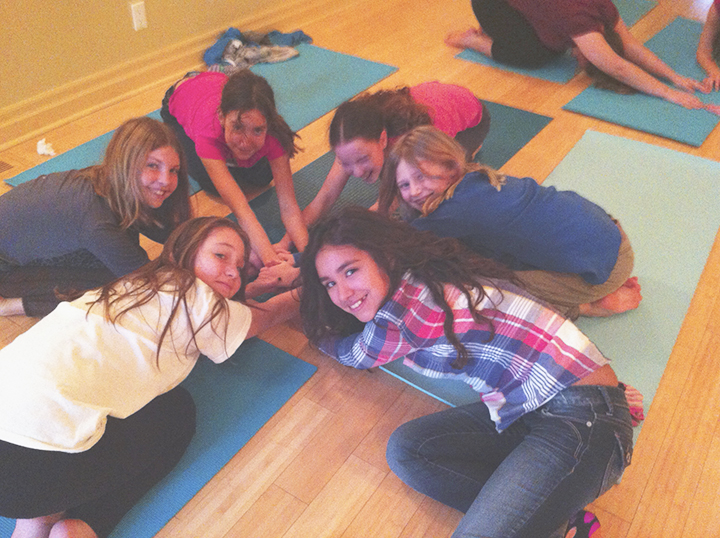 Teen Yoga circled child's pose, very giggly