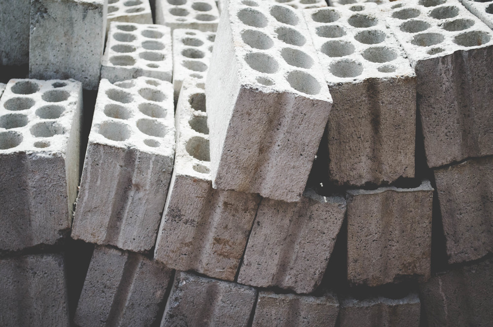 Each concrete block and brick is made by hand