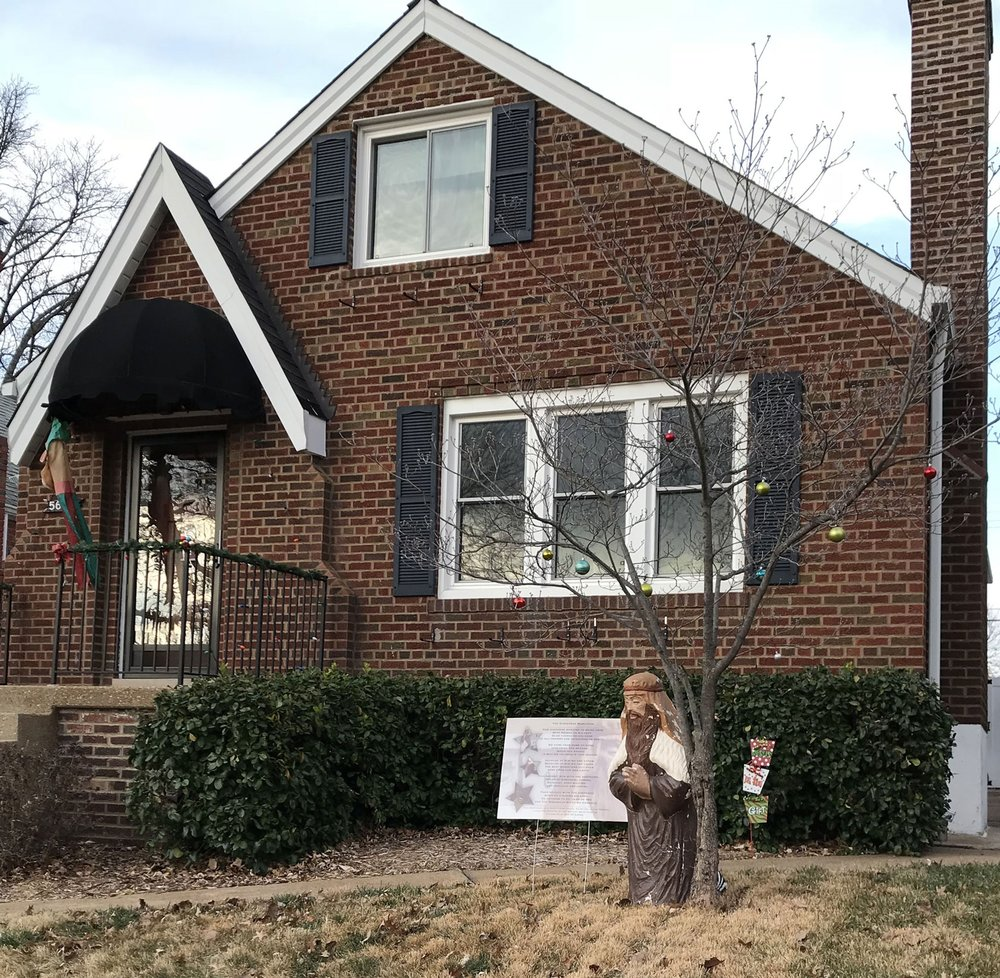 "Slowing down, only made it up the hill on Pernod to the 5600 block.  I agree with this home's sign stating ""Jesus is the gift!'  I've almost finished my race, can't wait to see all four Advent candles lit this Sunday, even if it's only for hours instead of days!"