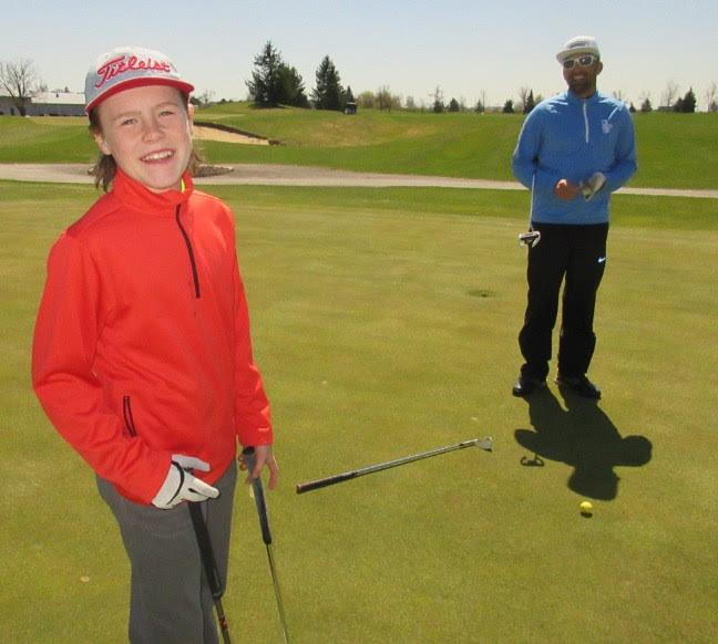 Tyler takes advanced golf lessons with Bradlee Ryall,- photo by Rob Campbell
