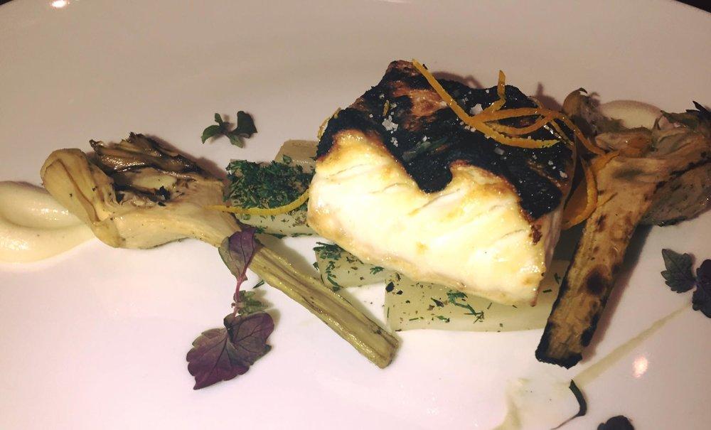 HALIBUT: Josper grilled halibut, tangerine infused salsify, artichokes, shiso.
