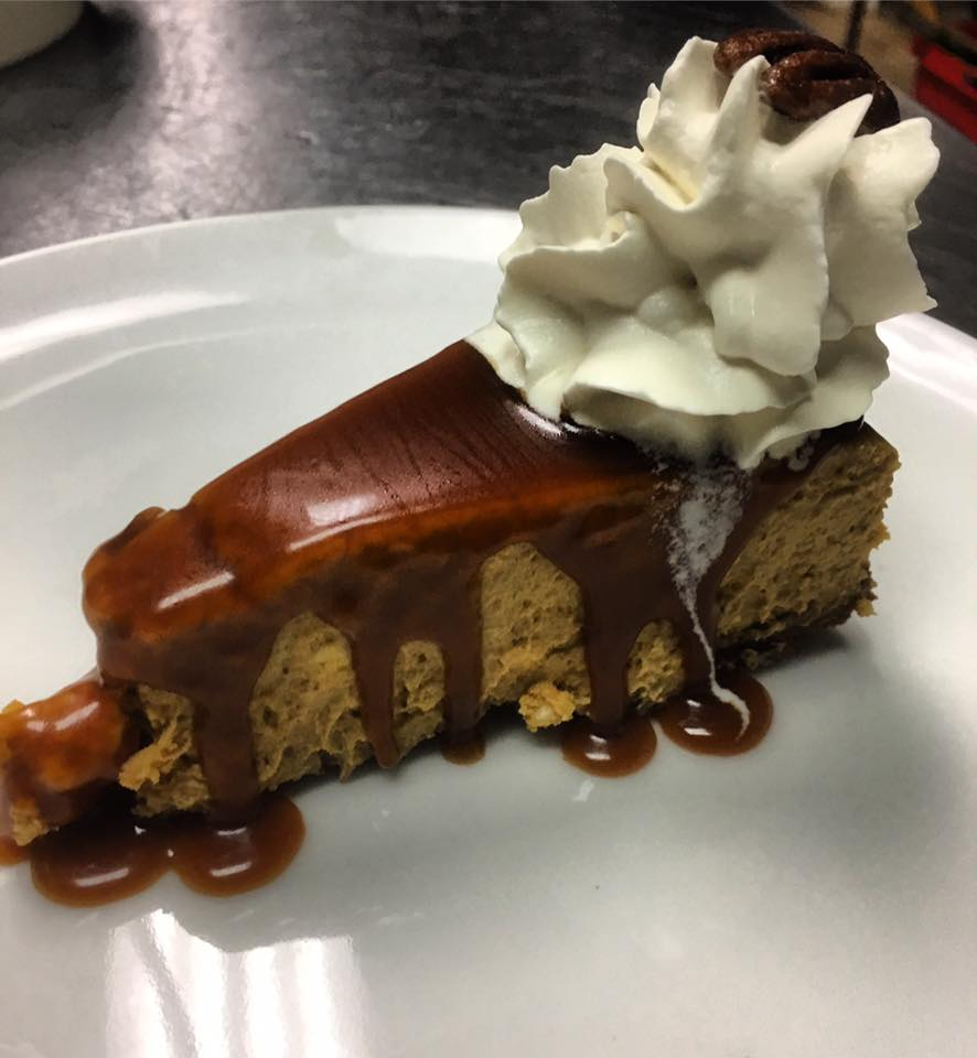 Pumpkin cheesecake with ginger snap crust, pumpkin spice roasted pecans caramel sauce and cream fraîche
