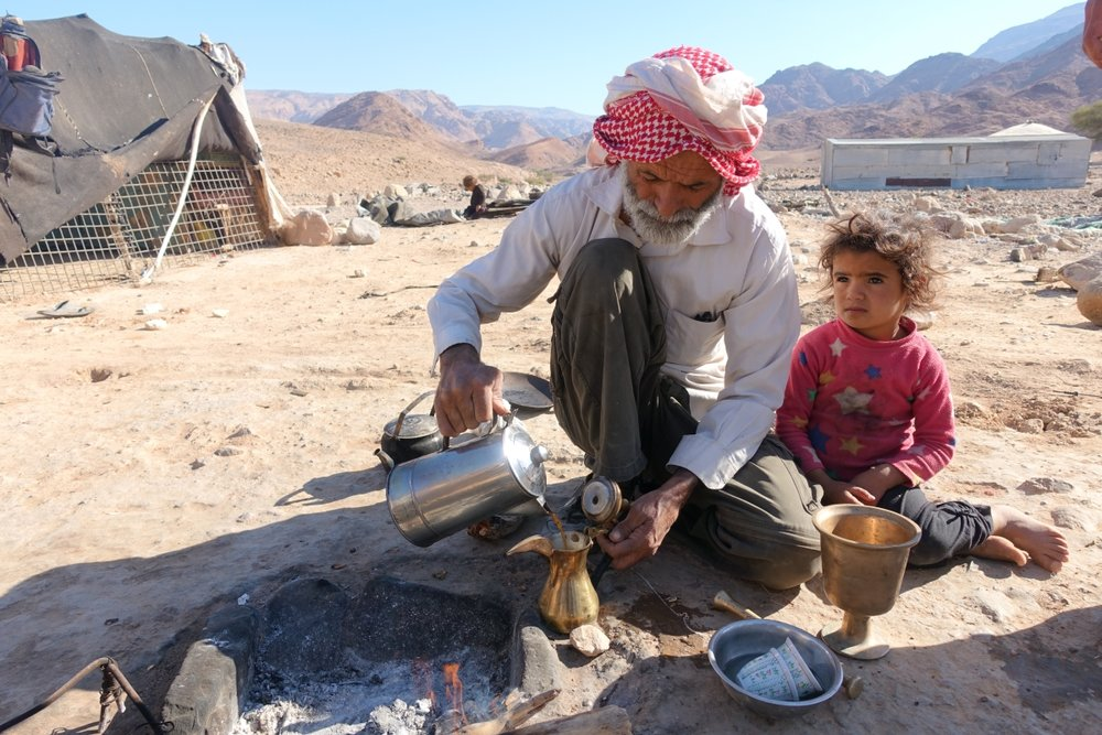 A local Bedouin and his daughter making Arabic coffee @ Brigitte Hasbron