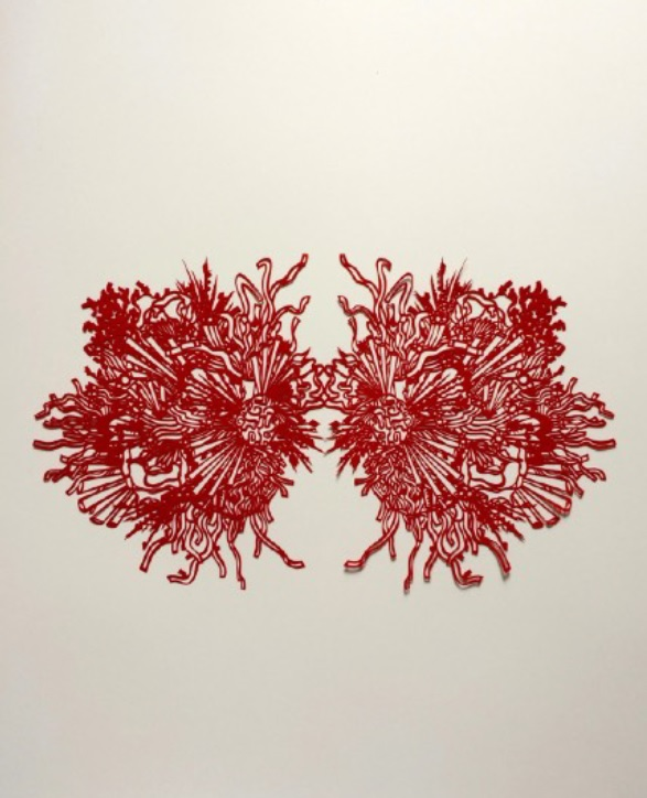 First place at the Art of Dialogue exhibit went to Fong Ki Wan's paper-cut titled Mind Blown.