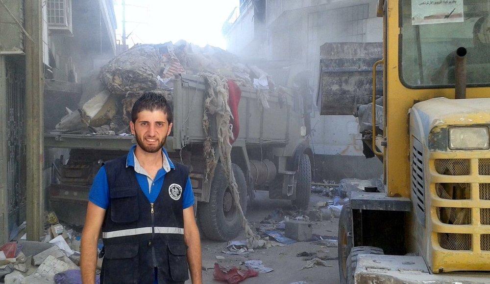 Abdulla Saad volunteering to help clean up in a devastated neighbourhood in Homs, Syria.