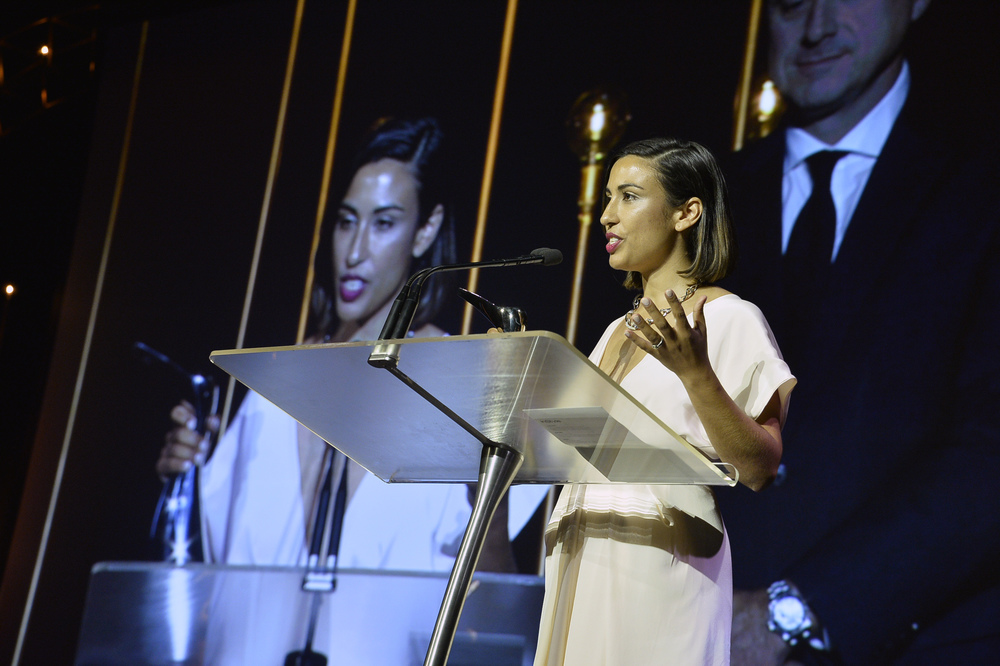 Dr Emma Fulu accepting the InStyle and Audi Style Scholarship at the awards ceremony in Sydney