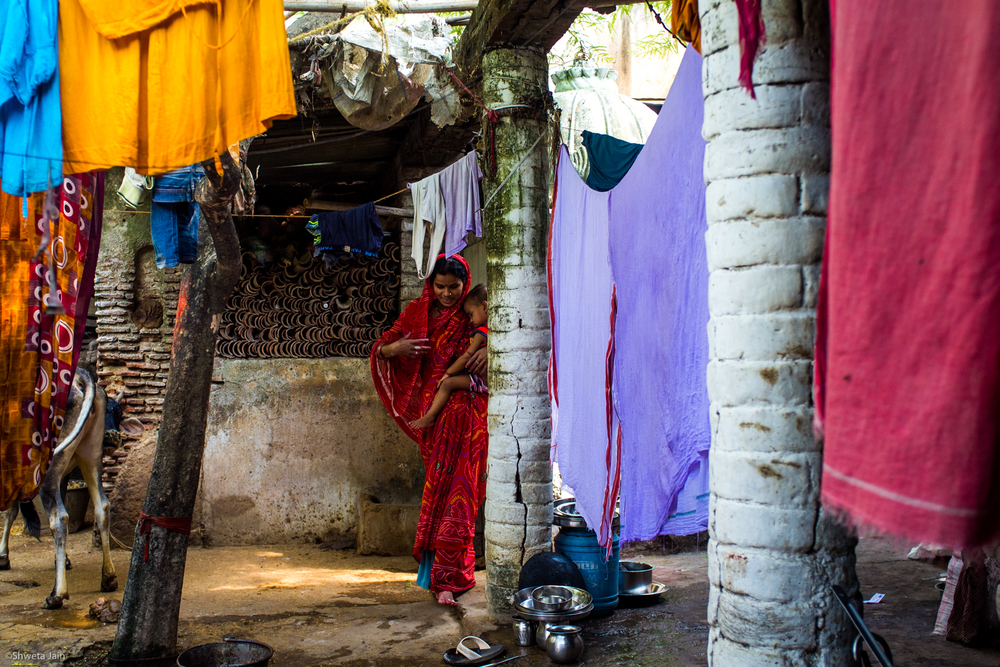 The house of our priest and his grand daughter. His family has been priests to our family since generations. Gaya, Bihar, India. 2015