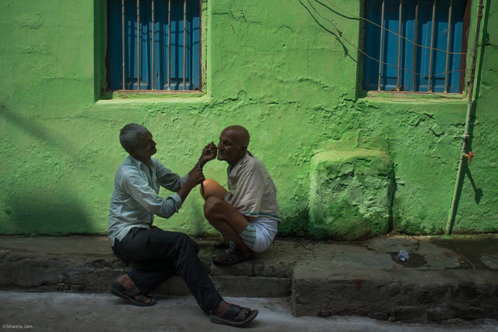 Shaving of hair before performing the ritual by male members, is one of part of 'Pind Daan' ritual. Gaya,Bihar, India. 2015.
