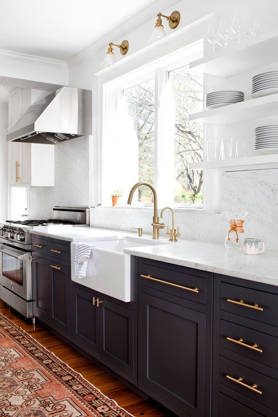 Design: Elizabeth Lawson Design Countertops & Backsplash: Carrara Marble