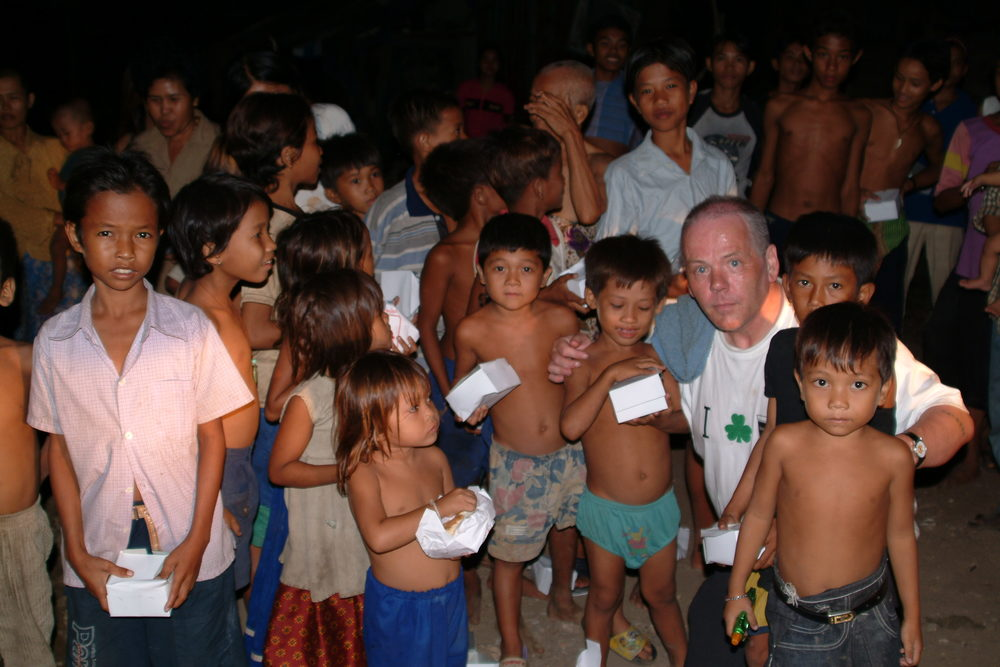 Ron feeding children on dump at night.jpg
