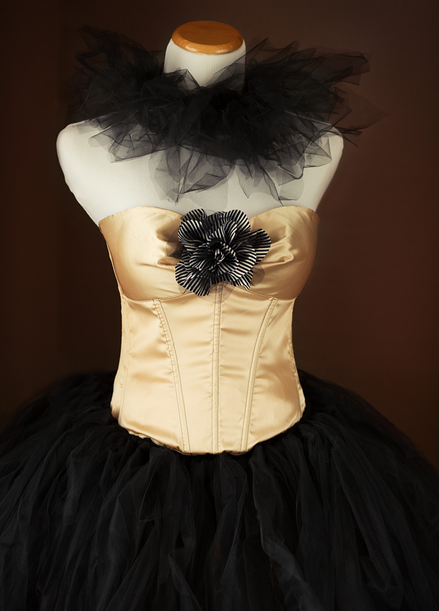 Gold corset in size 38 but can be adjusted to fit up or down a bit.  Black Tulle Skirt and neck wrap.